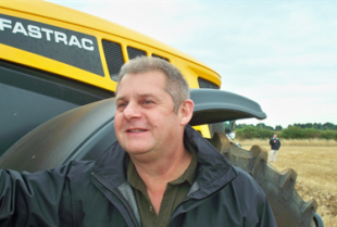 Jonathan Payne, Catchment Sensitive Farming Officer, in front of a tractor on a farm